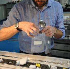 UCSC researcher Patrick Fulton is shown with core samples from the drilling operation.