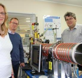 This image depicts from lef to right Dr Martha Clokie, Professor Andy Ellis and Professor Paul Monks from the University of Leicester with the mass spectrometer