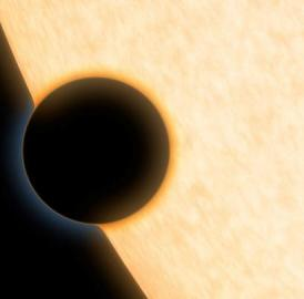 This is an artist's concept of the silhouette of the extrasolar planet HAT-P-11b as it passes its parent star. The planet was observed as it crossed in front of its star in order to learn more about its atmosphere.