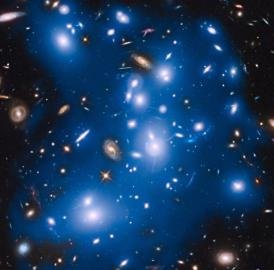 Massive galaxy cluster Abell 2744, nicknamed Pandora's Cluster, takes on a ghostly look where total starlight has been artificially colored blue in this Hubble view.