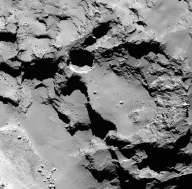 This close-up image shows the most active pit, known as Seth_01, observed on the surface of comet 67P/Churyumov-Gerasimenko by the Rosetta spacecraft. A new study suggests that this pit and others like it could be sinkholes, formed by a surface collapse process similar to the way these features form on Earth.