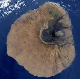Geologists think that the eastern slope of Fogo volcano crashed into the sea some 65,000 to 124,000 years ago, leaving a giant scar where a new volcano can be seen growing in this satellite image.