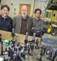 Graham Fleming (center) shown here with Tae Ahn (left) and  Yuan-Chung Cheng, post-doctoral researchers in his group, were among the co-authors of a paper in the journal Science that provided the first detailed picture ever obtained of the molecular mechanism behind the regulation of light harvesting energy during photosynthesis.
