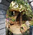 Only children really fit through the arch and in the tiny mushroom house (with its glowing roof), part of the Camden City Garden Club's Children's Garden exhibit.