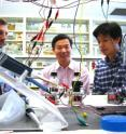This photo shows Bruce E. Logan, Shaoan Cheng and Defeng Xing with a microbial cell that produces methane directly from electricity.