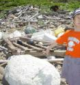 A boy in Japan points out Styrofoam debris from the ocean.