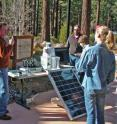 Nevada Seismological Laboratory director Graham Kent presents the new solar-powered wi-fi Forest Eye camera system to students who developed novel idea for early-detection of forest fires.