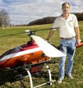 Kevin Kochersberger, a research associate professor with the Virginia Tech College of Engineering and director of the Virginia Tech Unmanned Systems Laboratory, and the autonomous helicopter.