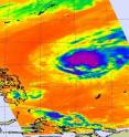 NASA's Aqua satellite captured cold thunderstorm cloud tops (purple) in the center of Tropical Storm Omais in this infrared image of March 25 at 12:41 a.m. EDT. Omais has doubled in size overnight.