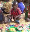 Zambian children eat a biofortified high-carotenoid maize meal as part of a feeding trial and nutritional study.