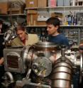 Graduate student Vincent Lonij (left), associate professor of physics Alex Cronin, research assistant Will Holmgren and undergraduate student Catherine Klauss perform maintenance on a chamber used to beam atoms through a grating to measure a tiny force that helps physicists better understand the structure of atoms.