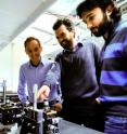 Research physicists Alberto Peruzzo (left), Jeremy O'Brien and Alberto Politi in front of the optical table.