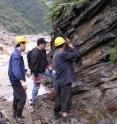 Charles Henderson (middle) of the University of Calgary collects material from a sedimentary layer in Shangsi, Sichuan Province, China. This was one of more important sections studied for ash layers and marine fossils used to pinpoint the dates and rate of Earth's massive extinction.