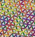 "Colored patches represent parallelogram outlines around pairs of triangles that have formed chiral super-structures. Parallelograms having different ""handedness"" and orientations are color-coded and superimposed over each other."