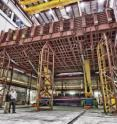 Scientists and engineers at Fermi National Accelerator Laboratory developed the 750,000-pound pivoter machine that will put the blocks of the NOvA detector in place.