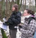 Lysanne Snijders (left), a doctoral student in the Netherlands, uses electronic tags, base stations and computer interface to study the social behavior of small woodland birds.