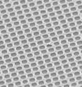 This electron microscope image shows the gold mesh created by Chou and colleagues. Each hole is 175 nanometers in diameter, which is smaller than the wavelength of light.