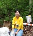 Post-doctoral researcher Yuehan Lu, Virginia Institute of Marine Science, collects field samples from the Chesapeake Bay watershed.