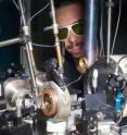 This image shows the experimental set-up of the experiment at ESRF beamline ID27 where the diffraction maps were recorded. The diamond anvil cell is inside the brass cylinder in the center. The image pictures Guillaume Morard, one of the co-authors of the publication, wearing laser safety goggles.