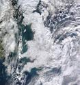 The satellite image shows widespread snowfall in the UK in December 2010. Other areas in Europe experienced relatively warm and wet conditions at this time, despite a weak inflow of air coming from the Atlantic (negative North Atlantic Oscillation). Credit NASA / Jeff Schmaltz.