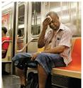 Heat-related fatalities are projected rise steeply in Manhattan due to warming climate. This man rode a subway car during an August 2006 heat wave.