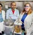 Brajendra Kumar Sharma (center) a senior research scientist at the Illinois Sustainable Technology Center at the U. of I., with research chemist Dheeptha Murali (left) and process chemist Jennifer Deluhery, converted plastic shopping bags into diesel fuel.