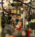 Pictured is a vacuum system that isolates ultracold atoms from room temperature and pressure. Atoms are suspended in this vacuum with laser beams, and manipulated with magnetic fields. A simple photograph taken with an infrared sensitive camera gives information about the atoms.