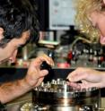 Ph.D. students Giovanni Guccione (left) and Harry Slatyer examine their gold coated nanowire probe in the Quantum Optics Laboratory at the Australian National University.