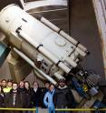 The University of Toledo observing team poses with the HPOL instrument (far right) mounted on the Ritter Observatory 1-m telescope. Graduate and undergraduate students in the Department of Physics & Astronomy conduct observations with HPOL every clear night.