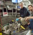 Doug Abernathy, left, ARCS instrument scientist at Oak Ridge National Laboratory, and Marc Janoschek, Los Alamos National Laboratory, prepare their sample for experiments at the Spallation Neutron Source.
