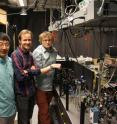 Brian Zhou, Christopher Yale, and F. Joseph Heremans, researchers at the University of Chicago's Institute for Molecular Engineering, with the optical apparatus they used to control geometric phases in diamond.