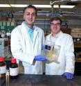 Amin Salehi-Khojin, UIC assistant professor of mechanical and industrial engineering (left), and postdoctoral researcher Mohammad Asadi with their breakthrough solar cell that converts atmospheric carbon dioxide directly into syngas.