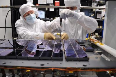A total of 106 CCDs make up Gaia's focal plane. Technicians from Astrium <stro />France</strong>, the Gaia mission&#8217;s prime contractor, are seen bolting and aligning the CCDs onto their support structure, at the company&#8217;s facility in Toulouse.The structure (the gray plate underneath the CCDs) weighs about 20 kg and is made of silicon carbide, a material that provides remarkable thermal and mechanical stability.Gaia&#8217;s CCDs are provided by e2v Technologies of Chelmsford, <strong>UK</strong>. Each <strong>CCD</strong> measures 4.7&#215;6 cm, with a thickness of only a few tens of microns. Precisely fitted together on the support structure, the gap between adjacent <strong>CCD</strong> packages is about 1 mm.&#8221; class=&#8221;image image_medium&#8221; /></a></p> <p>The largest digital camera ever built for a space mission has been painstakingly mosaicked together from 106 separate electronic detectors. The resulting &#8220;billion-pixel array&#8221; will serve as the super-sensitive &#8216;eye&#8217; of <strong>ESA</strong>&#8216;s <strong>Galaxy</strong>-mapping Gaia mission. While the naked human eye can see several thousand stars on a clear night, Gaia will map a billion stars within our own <strong>Milky Way</strong> <strong>Galaxy</strong> and its neighbours over the course of its five-year mission from 2013, charting their brightness and spectral characteristics along with their three-dimensional positions and motions.</p> <p>In order to detect distant stars up to a million times fainter than the eye can see, Gaia will carry 106 charge coupled devices (CCDs), advanced versions of chips within standard digital cameras. </p> <p>Developed for the mission by e2v Technologies of Chelmsford, <strong>UK</strong>, these rectangular detectors are a little smaller than a credit card, each one measuring 4.7&#215;6 cm but thinner than a human hair. </p> <p>The 0.5&#215;1.0 m mosaic has been assembled at the Toulouse facility of Gaia prime contractor Astrium <strong>France</strong>.</p> <p>Technicians spent much of May carefully fitting together each <strong>CCD</strong> package on the support structure, leaving only a 1 mm gap between them. Working in double shifts in strict cleanroom conditions, they added an average four CCDs per day, finally completing their task on 1 June.</p> <p>&#8220;The mounting and precise alignment of the 106 CCDs is a key step in the assembly of the flight model focal plane assembly,&#8221; said <strong>Philippe Gar</strong>é, <strong>ESA</strong>&#8216;s Gaia payload manager.</p> <p>The completed mosaic is arranged in seven rows of CCDs. The main array comprises 102 detectors dedicated to star detection. Four others check the image quality of each telescope and the stability of the 106.5º angle between the two telescopes that Gaia uses to obtain stereo views of stars.</p> <p>In order to increase the sensitivity of its detectors, the spacecraft will maintain their temperature of -110º Celsius.</p> <p>Gaia&#8217;s <strong>CCD</strong> support structure, like much of the rest of the spacecraft, is made of silicon carbide – a ceramic like material, extraordinarily resistant to deforming under temperature changes. </p> <p>First synthesised as a diamond substitute, SiC has the advantage of low weight: the entire support structure with its detectors is only 20 kg.</p> <p>Gaia will operate at the <strong>Earth</strong>–<strong>Sun</strong> L2 Lagrange point, 1,5 million kilometers behind the earth, when looking from the sun, where <strong>Earth</strong>&#8216;s orbital motion balances out gravitational forces to form a stable point in space. As the spinning Gaia&#8217;s two telescopes sweep across the sky, the images of stars in each field of view will move across the focal plane array, divided into four fields variously dedicated to star mapping, position and motion, colour and intensity and spectrometry.</p> <p>Scheduled for launch in 2013, Gaia&#8217;s three-dimensional star map will help to reveal the composition, formation and evolution of the <strong>Milky Way</strong>, sampling 1% of our <strong>Galaxy</strong>&#8216;s stars. </p> <p>Gaia should also sample large numbers of other celestial bodies, from minor bodies in our own <strong>Solar</strong> System to more distant galaxies and quasars near the edge of the observable Universe.</p> <h2>Source: <a href=