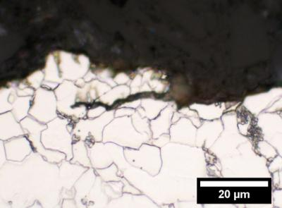 "Micrograph of crack in X52 steel after the sample was subjected to mechanical forces for several days in an ethanol solution containing acid-producing bacteria, Acetobacter aceti. Researchers at <strong>NIST</strong>'s biofuels testing facility found that the bacteria increased fatigue crack growth rates at least 25-fold compared to what would occur in air."" class=""image image_medium"" /></a></p> <p>U.S. production of ethanol for fuel has been rising quickly, topping 13 billion gallons in 2010. With the usual rail, truck and barge transport methods under potential strain, existing gas pipelines might be an efficient alternative for moving this renewable fuel around the country. But researchers at the National Institute of Standards and <strong>Technology</strong> (<strong>NIST</strong>) caution that ethanol, and especially the bacteria sometimes found in it, can dramatically degrade pipelines. At a conference this week,* <strong>NIST</strong> researchers presented new experimental evidence that bacteria that feed on ethanol and produce acid boosted fatigue crack growth rates by at least 25 times the levels occuring in air alone.</p> <p>The <strong>NIST</strong> team used a new biofuels test facility to evaluate fatigue-related cracking in two common pipeline steels immersed in ethanol mixtures, including simulated fuel-grade ethanol and an ethanol-water solution containing common bacteria, Acetobacter aceti. Ethanol and bacteria are known to cause corrosion, but this is the first study of their effects on fatigue cracking of pipeline steels.</p> <p>""We have shown that ethanol fuel can increase the rate of fatigue crack growth in pipelines,"" <strong>NIST</strong> postdoctoral researcher <strong>Jeffrey Sowards</strong> says. ""Substantial increases in crack growth rates were caused by the microbes. These are important data for pipeline engineers who want to safely and reliably transport ethanol fuel in repurposed oil and gas pipelines.""</p> <p>Ethanol, an alcohol that can be made from corn, is widely used as a gasoline additive due to its oxygen content and octane rating. Ethanol also can be used as fuel by itself in modified engines. The <strong>NIST</strong> tests focused on fuel-grade ethanol.</p> <p>The tests were performed on X52 and X70 pipeline steels, which are alloys of more than a dozen metals. Simulated fuel-grade ethanol significantly increased crack growth at stress intensity levels found in typical pipeline operating conditions, but not at low stress levels. The cracking is related to corrosion. The X70 steel, which is finer-grained than X52, had lower rates of crack growth at all stress levels. This was expected because larger grain size generally reduces resistance to fatigue. In the bacteria-laden solutions, acid promoted crack growth at stress intensity levels found in typical pipeline operating conditions.</p> <p>Preliminary tests also suggested that glutaraldehyde, a biocide used in oil and gas operations, may help control bacterial growth during ethanol transport.</p> <p>The findings are the first from <strong>NIST</strong>'s biofuels test facility, where material samples are installed in hydraulic test frames and subjected to load cycles while immersed in fuel inside a transparent polymer tank. Fatigue crack growth and other properties are observed over a period of up to 10 days. <strong>NIST</strong> staff expect to continue and possibly expand the research to other potential biofuels such as butanol or biodiesel.</p> <p>Collaborators at the Colorado School of Mines provided the bacteria, which were isolated from industrial ethanol storage tanks. The research was supported by the U.S. Department of Transportation.</p> <h2>Source: <a href="