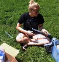 University of Cincinnati student researcher Lily Soderlund collects soil samples in Burnet Woods as part of professor Amy Townsend-Small's research on urban lawn management.