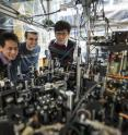 University of Chicago scientists can create an exotic, particle-like excitation called a roton in superfluids with the tabletop apparatus pictured here. Posing from left are graduate students Li-Chung Ha and Logan Clark, and physics Professor Cheng Chin.