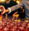 Bartenders pour whiskey at Drexel's annual Philly Chef Conference, hosted by the Center for Hospitality and Sport Management. In a recent study, a Drexel food scientist found that rye and bourbon whiskeys, despite popular opinion, are not discriminable for average consumers.
